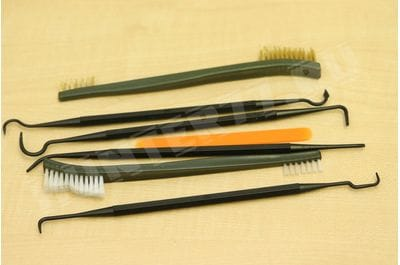 A set of items for cleaning weapons